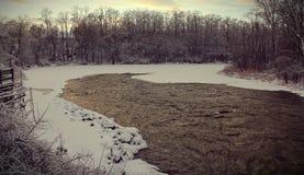 Suburbs on Ice River 2. Image of a suburban neighborhood on a half frozen river in Burlington, Vermont Stock Photo
