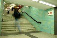 Subway. Man running to catch the underground train Stock Images