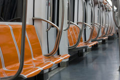 Subway Seat Vacant Interior Wagon. Interior of a modern subway car with vacant seats Stock Image