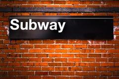 Subway. New York City subway sign entrance on brick wall Royalty Free Stock Photography