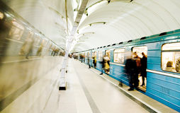 In subway. Crowd leaving the train in subway station Royalty Free Stock Image