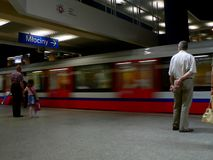 Subway arriving at station. In Warsaw with commuters standing Stock Photo