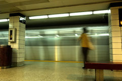 Subway Business Woman. A business woman blurred by motion passing by a speeding subway train Royalty Free Stock Photos