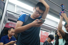 Subway car to play with the phone's passengers, in Shenzhen Stock Image