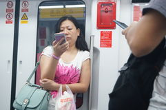 Subway car to play with the phone's passengers, in Shenzhen Royalty Free Stock Image