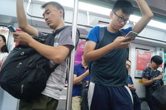 Subway car to play with the phone's passengers, in Shenzhen Royalty Free Stock Images