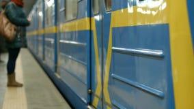 Subway cars arrive at the station. Underground transport. Passengers enter the subway wagon stock photo