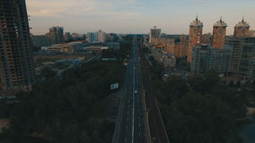 Subway and cars bridge. Cityscape on dusk aerial drone footage. UHD stock video