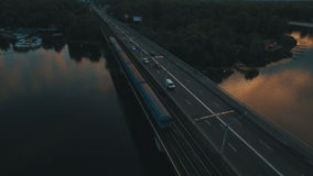 Subway and cars bridge. Cityscape on dusk aerial drone footage. UHD stock video footage