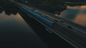 Subway and cars bridge.Cityscape on dusk aerial drone footage. UHD stock footage