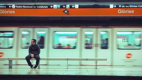 Subway Cinemagraph. Man Sitting on platform waiting for train. Cinemagraph of moving train and stationary man stock footage