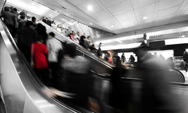 Subway elevator. Business people rushing on the escalator in motion blur on the subway station Stock Images