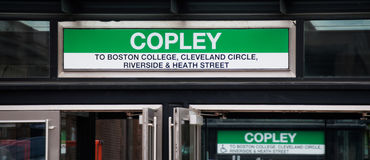 Subway entrance signs at Copley Station in Boston. Subway entrance signs over doors at Copley Station in Boston, Massachusetts, with copy space Stock Images