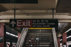 Subway exit sign to 49s, 50s street and Rockefeller Center from subway platform in New York, USA. stock photos