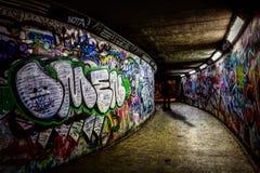 Subway Graffiti. Colourful graffiti lines a subway corridor stock image