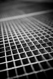 Subway Grate Texture. Black and white close up of a sidewalk subway grate with shallow depth of field royalty free stock images