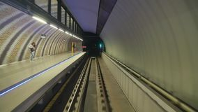 Subway journey point of view. BUDAPEST, HUNGARY - OCTOBER 3, 2016: Subway journey view in dark tunnel. Many argue that metro line 4 has stations too close to stock footage