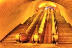 Subway of Lisboa. Tunnel with a long row moving stairways leading deep down to the underground subway trains of Lisboa Portugal Stock Images
