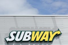 Subway logo on a facade. Bremen, Germany - July 31, 2015: Subway logo on a facade. Subway is an American fast food restaurant franchise that primarily sells Stock Photos