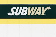 Subway logo on a facade. Lozanne, France - July 7, 2016: Subway logo on a facade. Subway is an American fast food restaurant franchise that primarily sells Royalty Free Stock Photo
