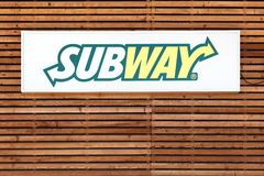 Subway logo on a facade. Neronde,  France - June 23, 2016: Subway logo on a facade. Subway is an American fast food restaurant franchise that primarily sells Stock Photo