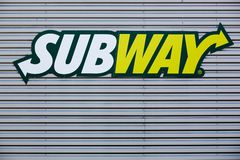 Subway logo on a facade. Villefranche sur Saone, France - May 24, 2015: Subway logo on a facade. Subway is an American fast food restaurant franchise that Stock Image