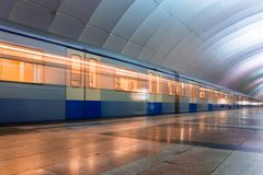 Subway metro train arriving at a station Stock Photos