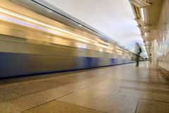 Subway metro train arriving at a station Stock Images