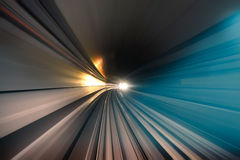 Subway metro underground tunnel with blurred lights. Subway tunnel with blurred light tracks in the gallery - Concept of modern metro underground transport and royalty free stock images
