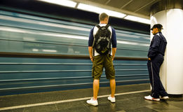 Subway motion blur. 2 young man waiting for the subway Royalty Free Stock Photo