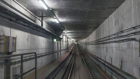 Subway rails in tunnel Stock Images