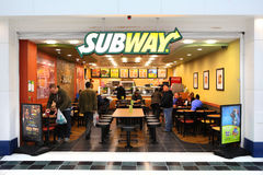 SUBWAY restaurant. Open front in shopping mall as people buy fast food sandwiches. One of the fastest growing franchises with over 40, 000 outlets around the
