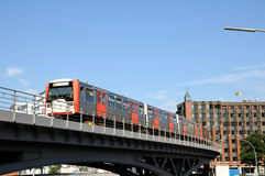 Subway ride in Hamburg. Metro runs over canal bridge in front of HafenCity Royalty Free Stock Photography