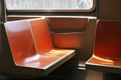 Subway seats. Orange seats on subway Stock Images