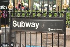 Subway sign and Entrance, New York City. A subway sign and entrance to a subway near Bryant Park, New York City royalty free stock photos