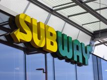 Subway sign on a restaurant building royalty free stock images