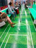 Subway With Soccer Field on the Floor. Subway car with a soccer field on its floor stock image