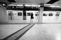 At the subway station. A girl alone at the subway station, train in motion Stock Photography