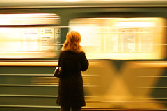 Subway station. Woman and subway train Stock Photo