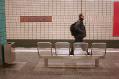 Subway station. Tierpark in berlin with chairs an a man walking past Stock Photos