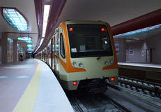Subway station. A train entering subway station Stock Photos