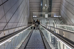 Subway station in Copenhagen. People on escalators in Metro subway station in Copenhagen, Denmark Royalty Free Stock Photos