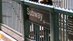 Subway station entrance. People walking down into a New York City Subway Station stock footage
