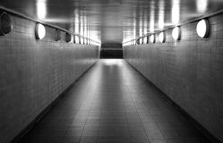 Subway Station Hallway Black and White. Pedestrian tunnel from a ghost train station with stairway leading outdoors Stock Images