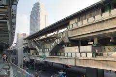 Subway station SkyTrain. Road, skyscraper and Bangkok citizens Royalty Free Stock Images