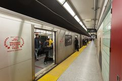 Subway Station in Toronto, Canada. Toronto, Canada - Oct 12, 2017: Train arriving at the platform of a subway station in the city of Toronto, Canada Stock Images