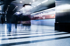 Subway station with train in motion Royalty Free Stock Photo
