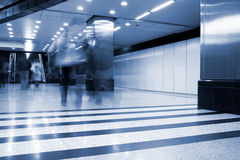 Subway station with train in motion Stock Images