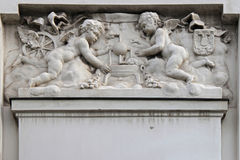 Subway station - Vienna - Austria. Two putti sculptured decorate the facade of a subway station in Vienna (Austria). deux putti sculptés décorent la faç royalty free stock photo