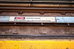 Subway Tracks Danger Sign Close Up. Symbol and message warning commuters to stay away from subway platform edge Stock Photo